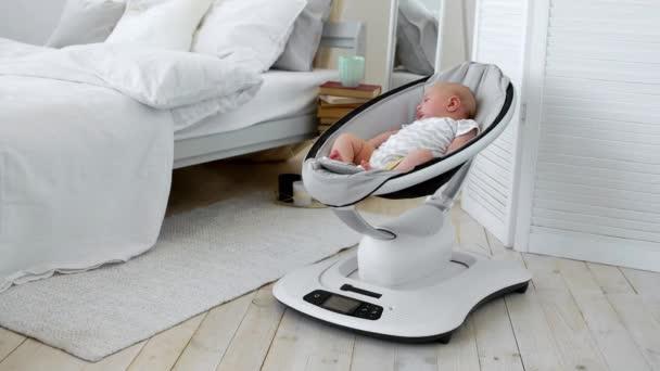 Baby sleeps in a rocking chair for children high-tech design in .