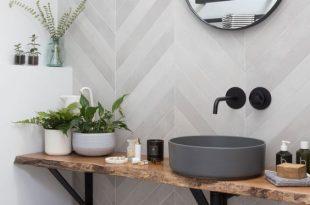 Create an organized spa-like bathroom with simplehuman bath tools .
