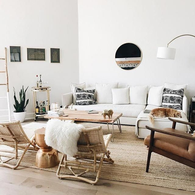 A mix of mid-century modern, bohemian, and industrial interior .