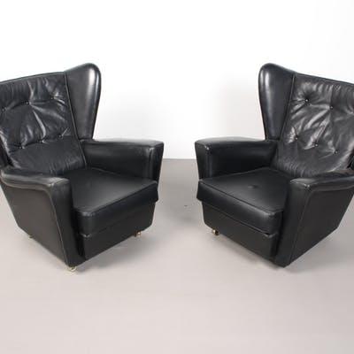 Paar schwarze Ledersessel / Sessel / Ohrensessel, HK-Design .