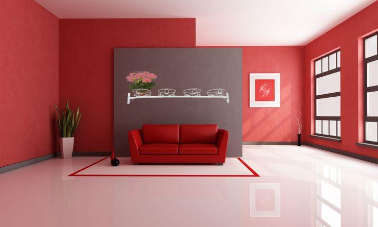 Wohnzimmer, rote Akzentwand und roter Ledersessel plus polierter .