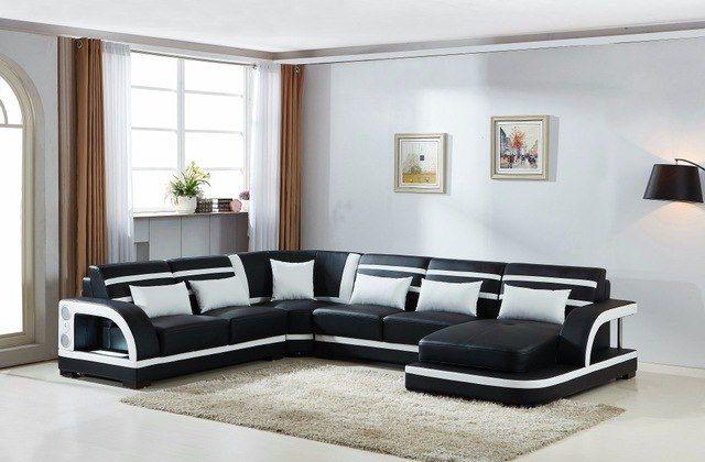 Schnittsofa aus Leder mit Liegesessel