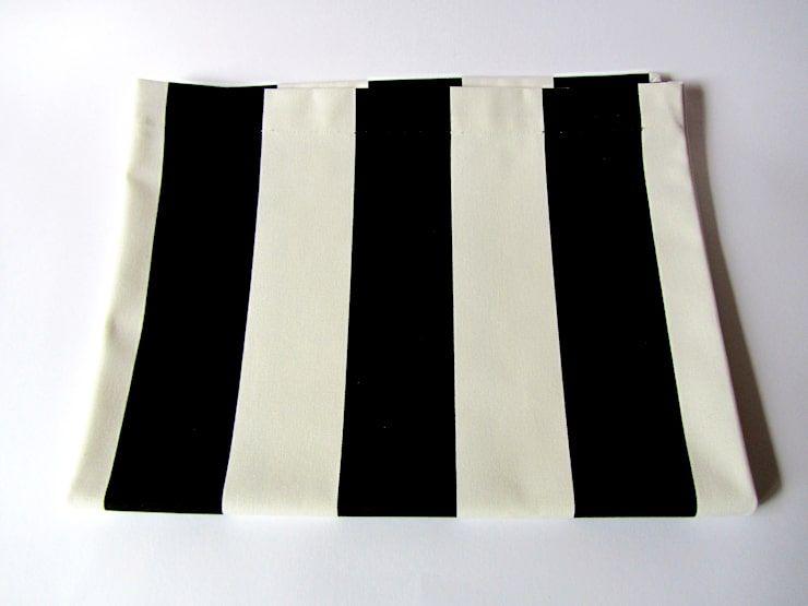 Die Bedeutung der schwarzen und weißen gestreiften Wolldecke .