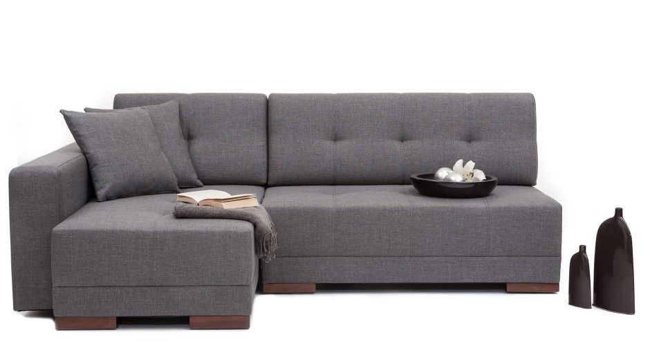 A wrap-around couch that converts into a double bed with a single .