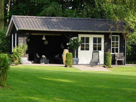 7. Schwarzes Gartenhaus mit Veranda und Terrassentüren 28m2 .