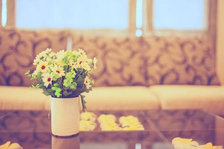 Vintage Vase Full Of Colorful Flowers On Glass Table With Sofa .